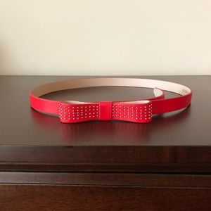 Red Express belt with bow and gold accents